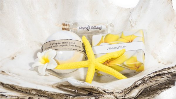 Frangipani gift pack with soap, bathbomb, Frangipani flower, message in a bottle and matching yellow Starfish